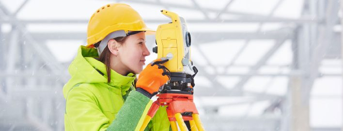 Lady in hardhat and camera
