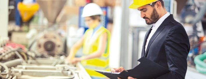 Man in suit and hardhat